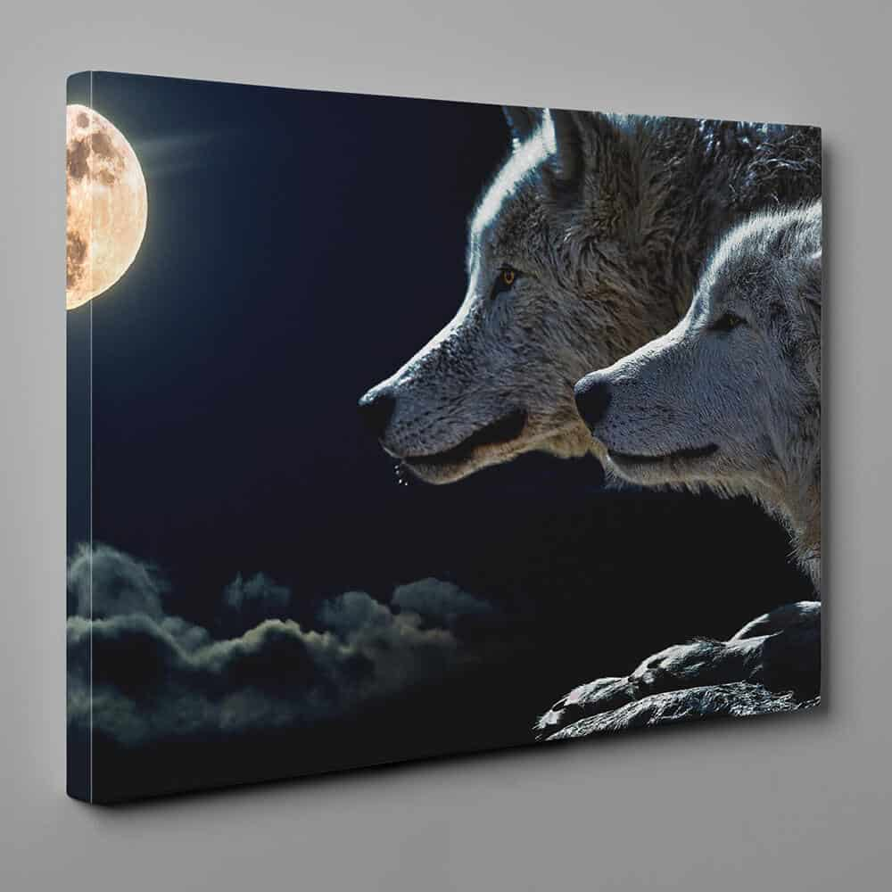a canvas print of a couple of wolf under the full moon