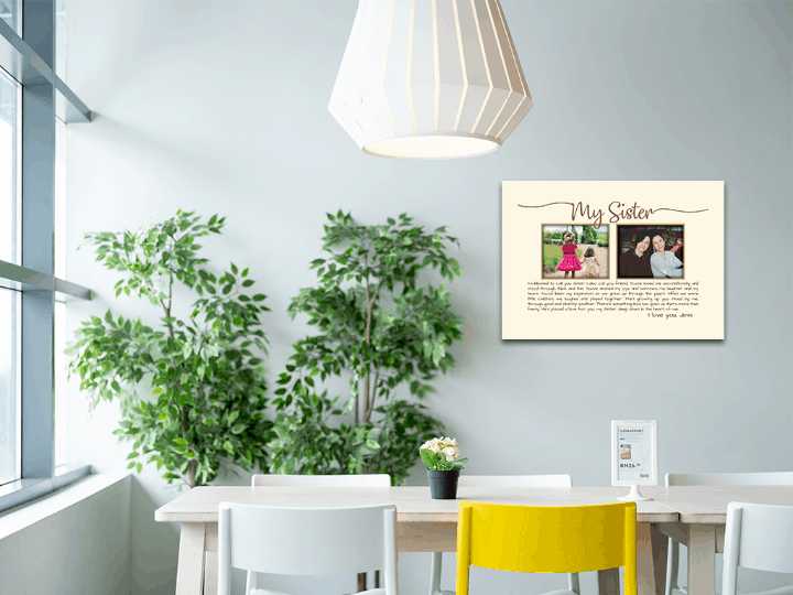 a 18-by-12-inch canvas print on a wall behind a table