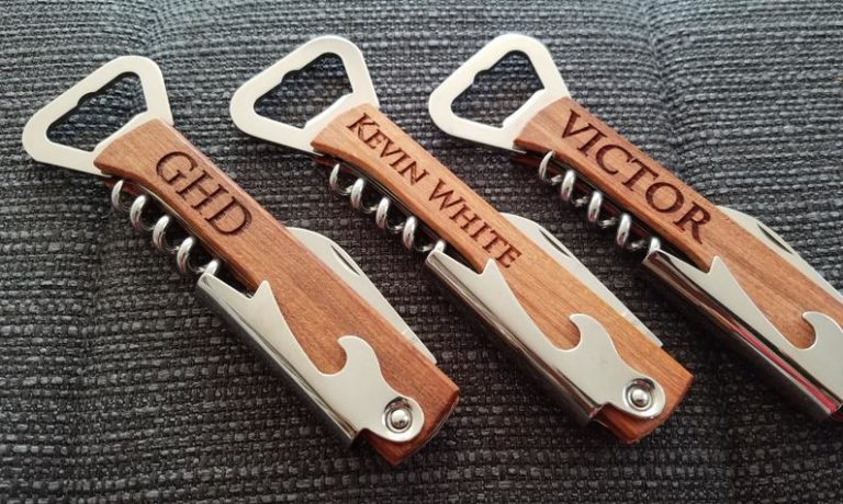 cool wood anniversary gift for him: engraved bottle opener