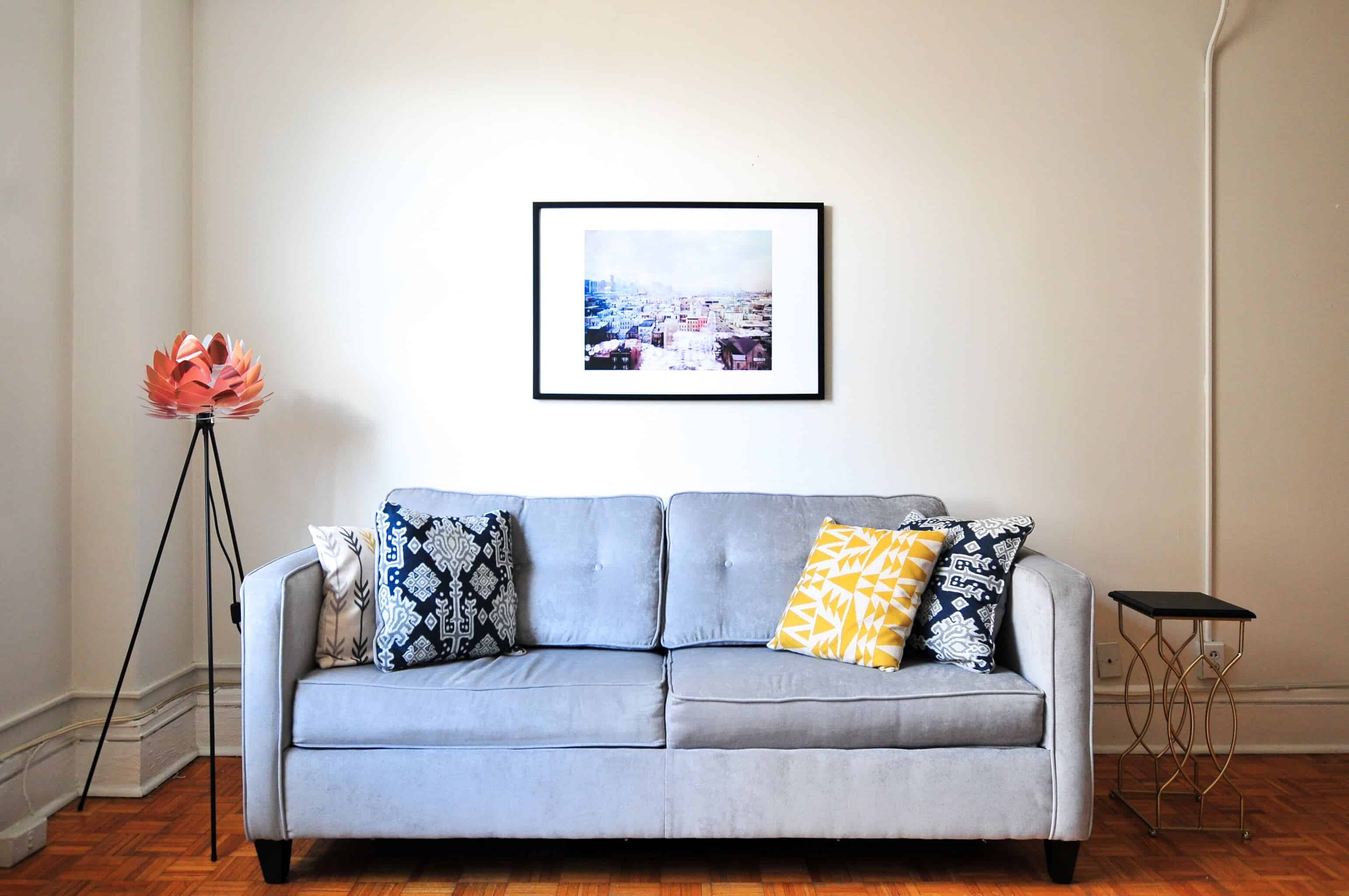 artwork placed above couch