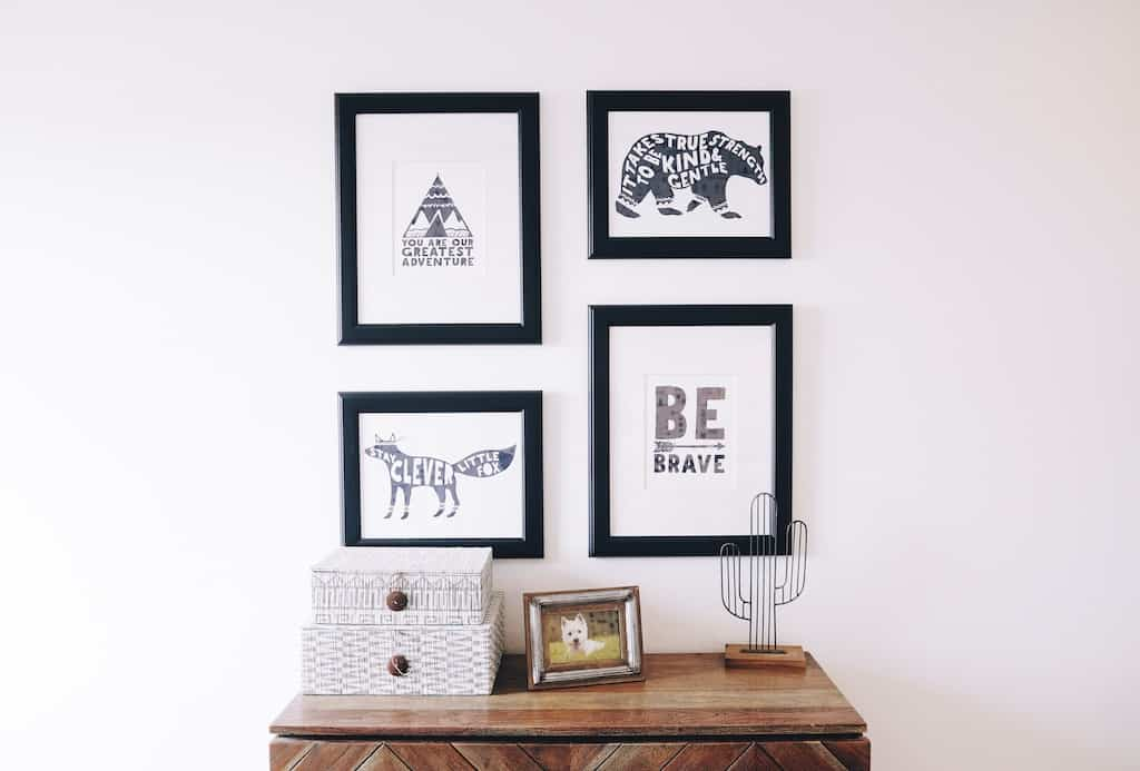 framed prints above a table