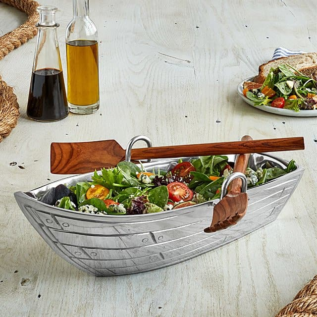 row boat serving bowl with wood serving utensils