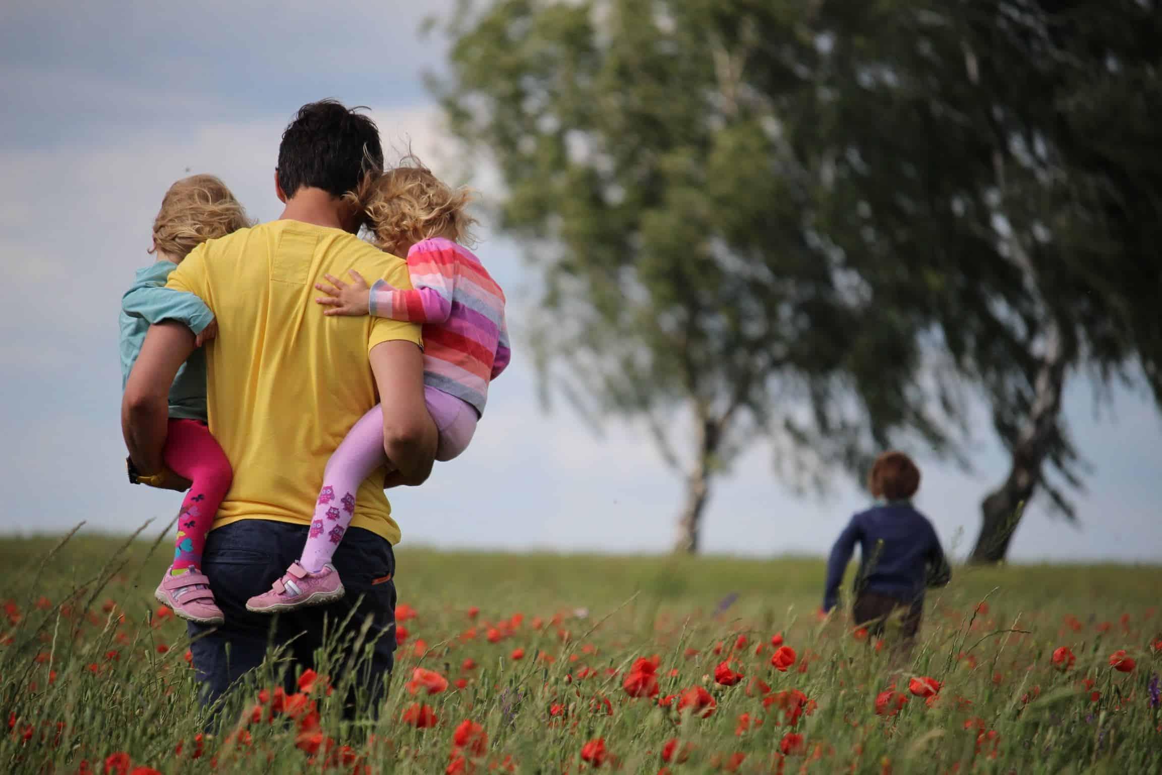 man carrying kids