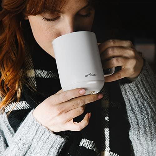 a woman using ember temperature control smart mug