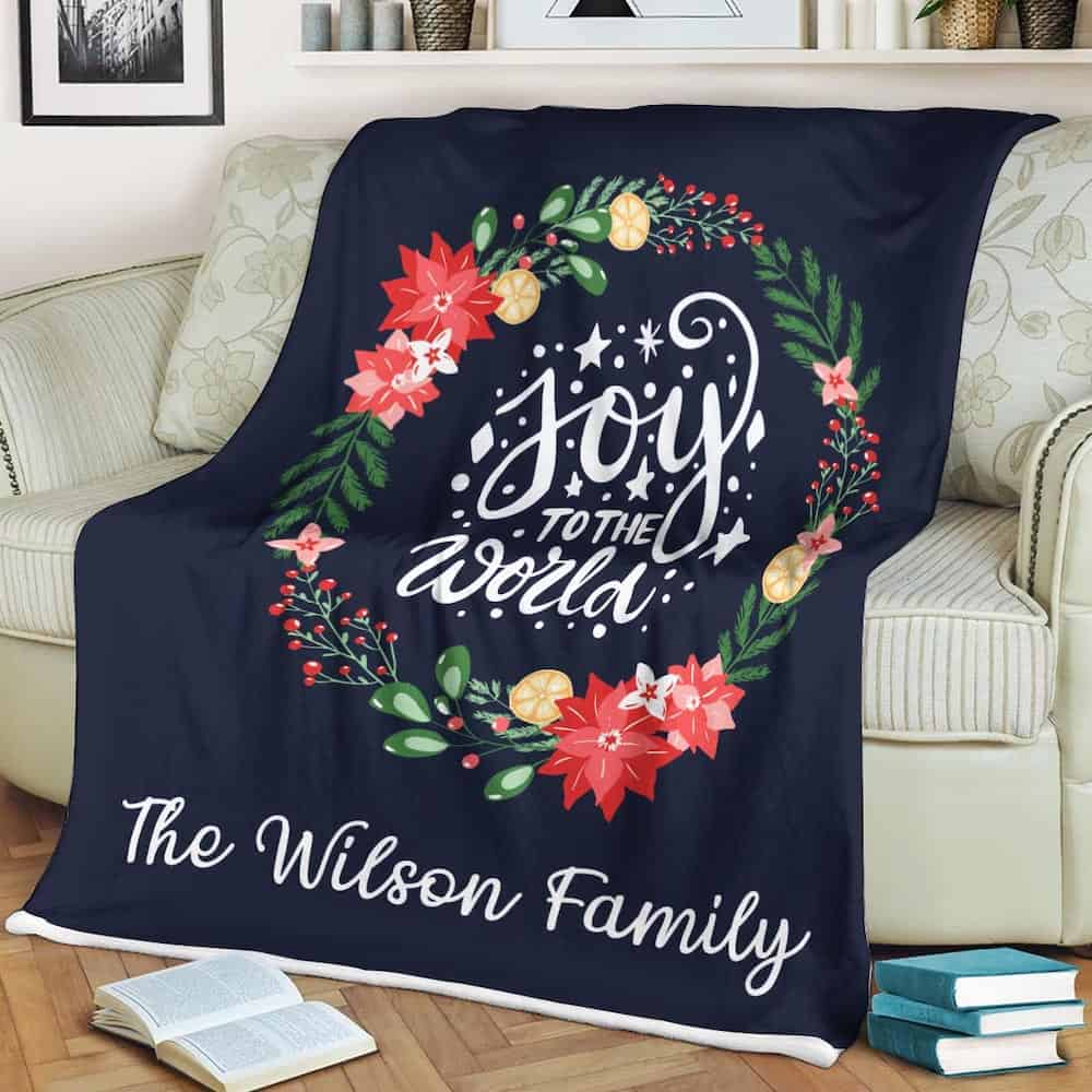 a custom blanket for mother-in-law with family name and the words Joy To The World
