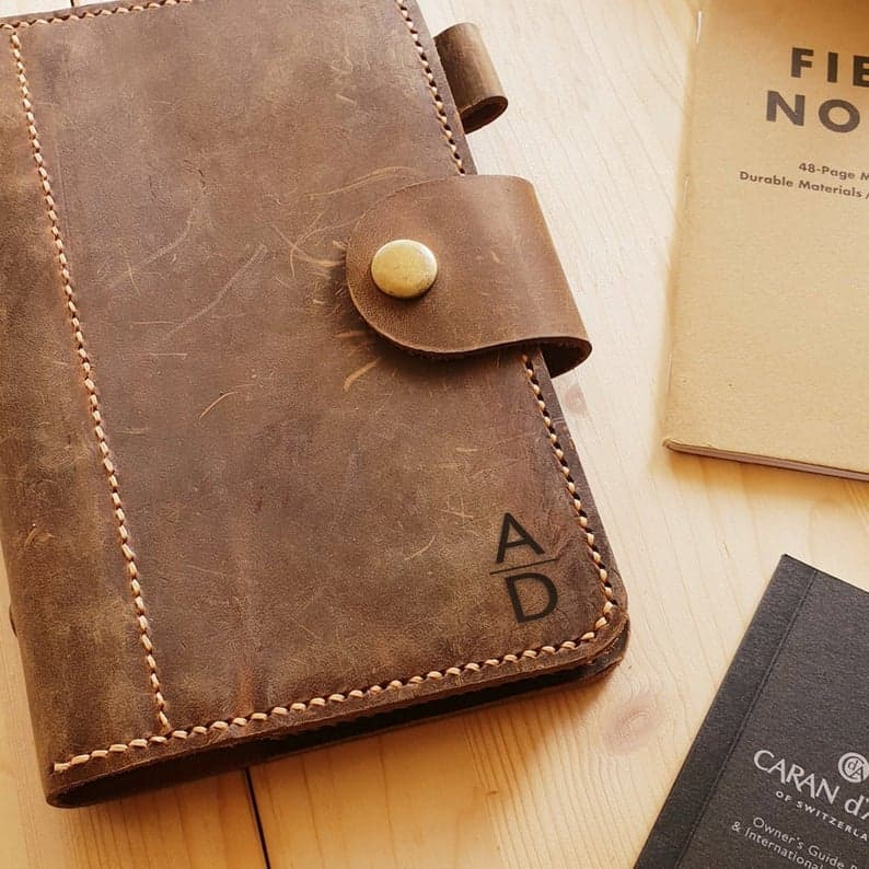 a leather notebook gift with brothers initials on it