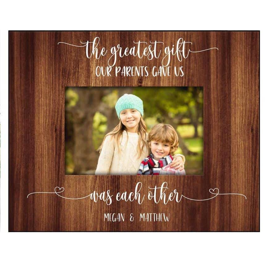 a photo frame of brother and sister with the quote the greatest gift that our parents gave us was each other