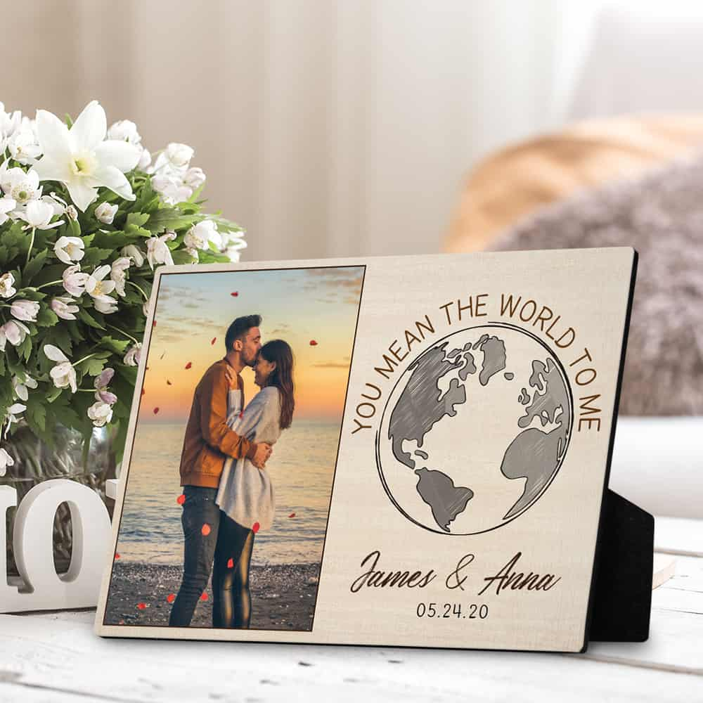 a desktop plaque with a photo of the couple and the quote you mean the world to me