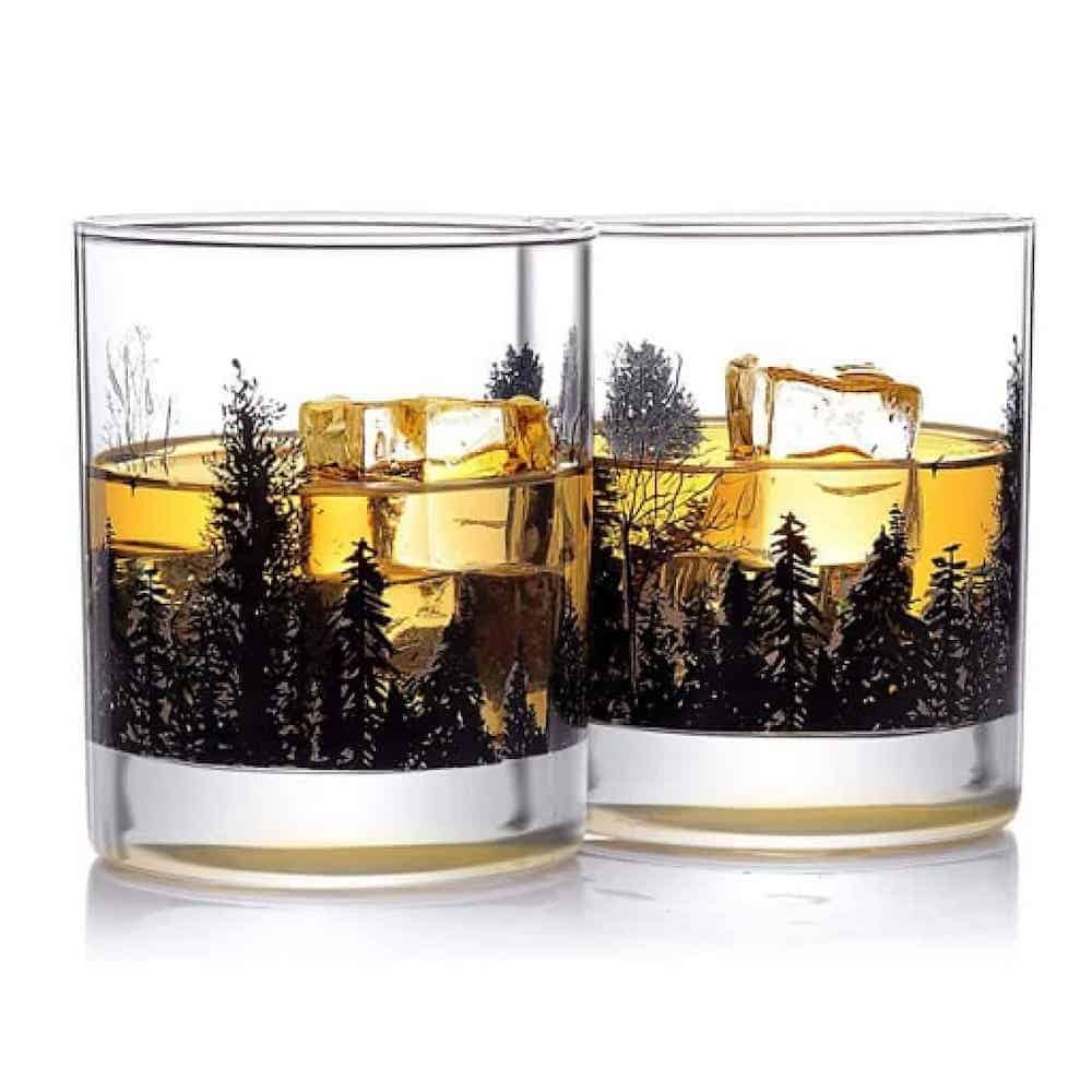 whiskey glasses with forest landscape