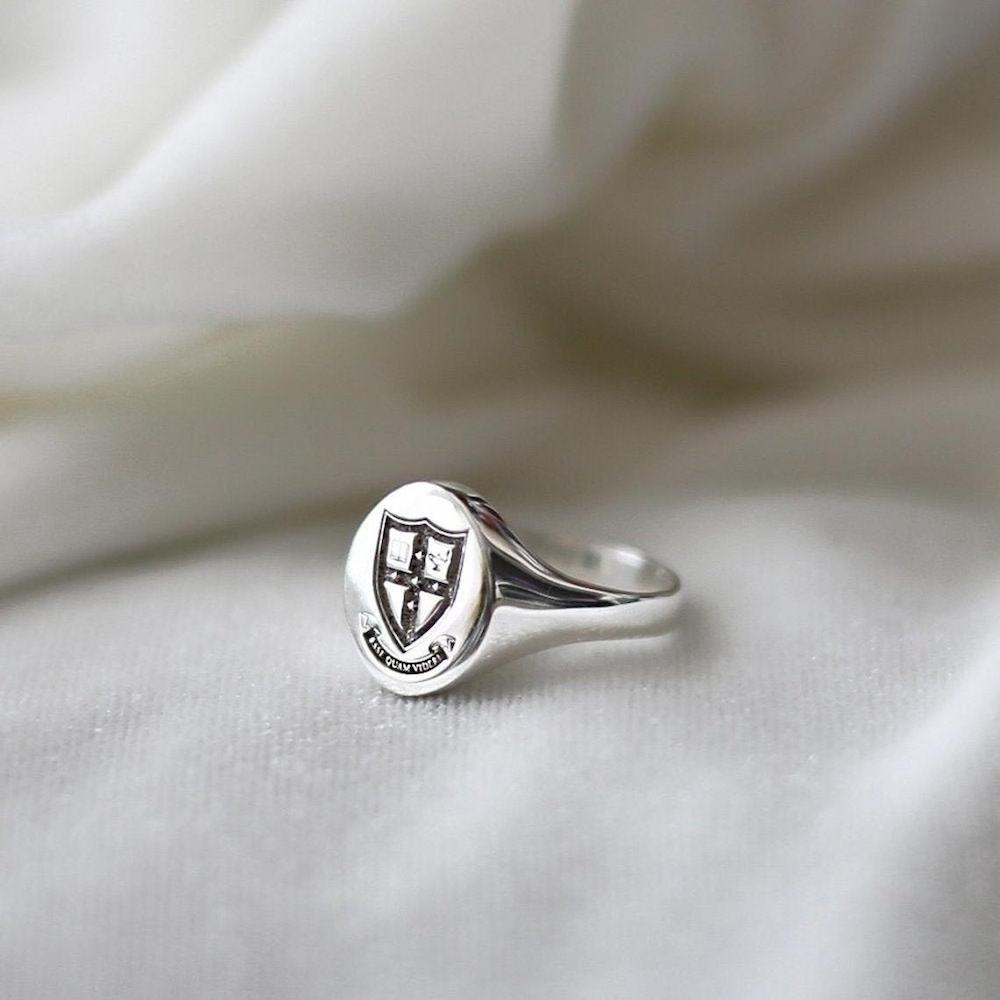 a college class ring as a personalized graduation gift for him