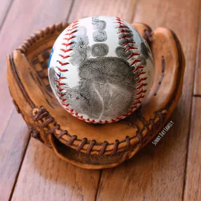 a baseball with handprint of baby: a gift for new dads on first father's day