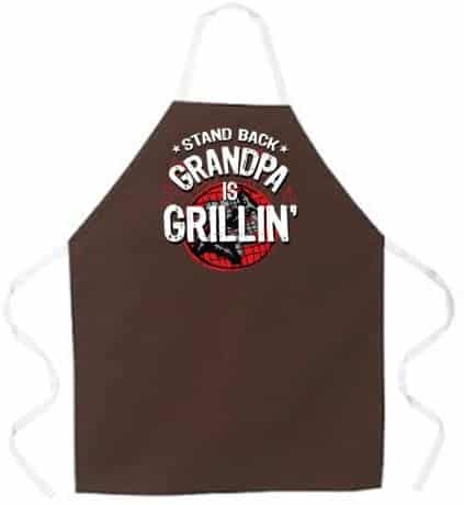 an apron gift for a new grandpa with a funny saying