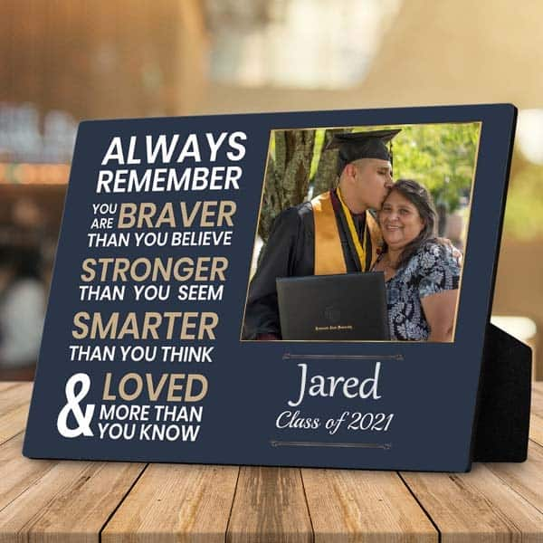 a desktop plaque with a picture of a male graduate and his mom