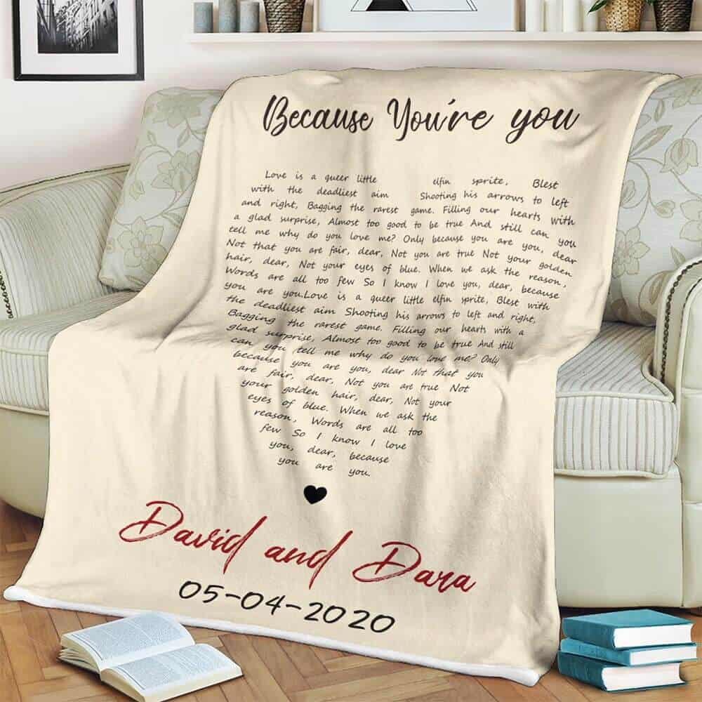 a modern 13th anniversary gift: a personalized blanket with song lyrics