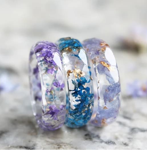 resin ring made with a dried symbolic flower of the sixteenth anniversary
