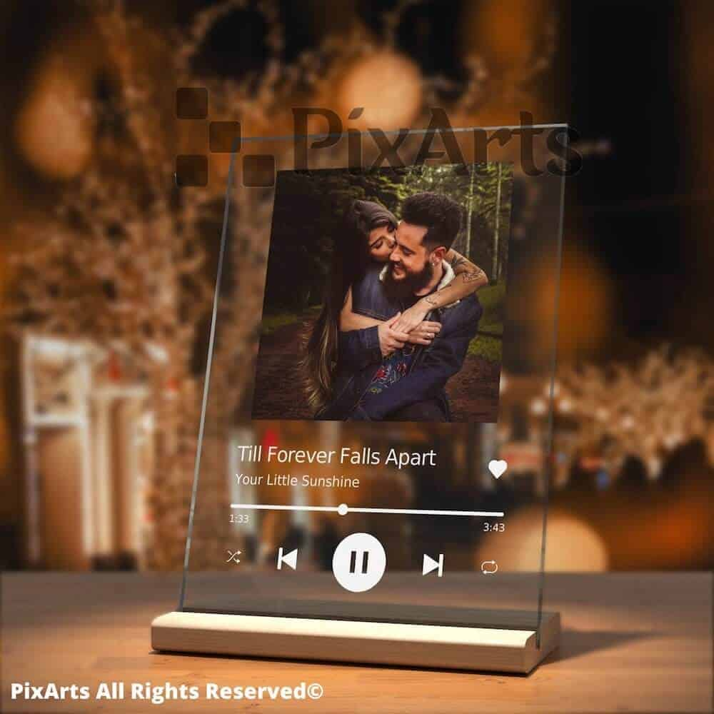 a glass photo plaque with music frame style