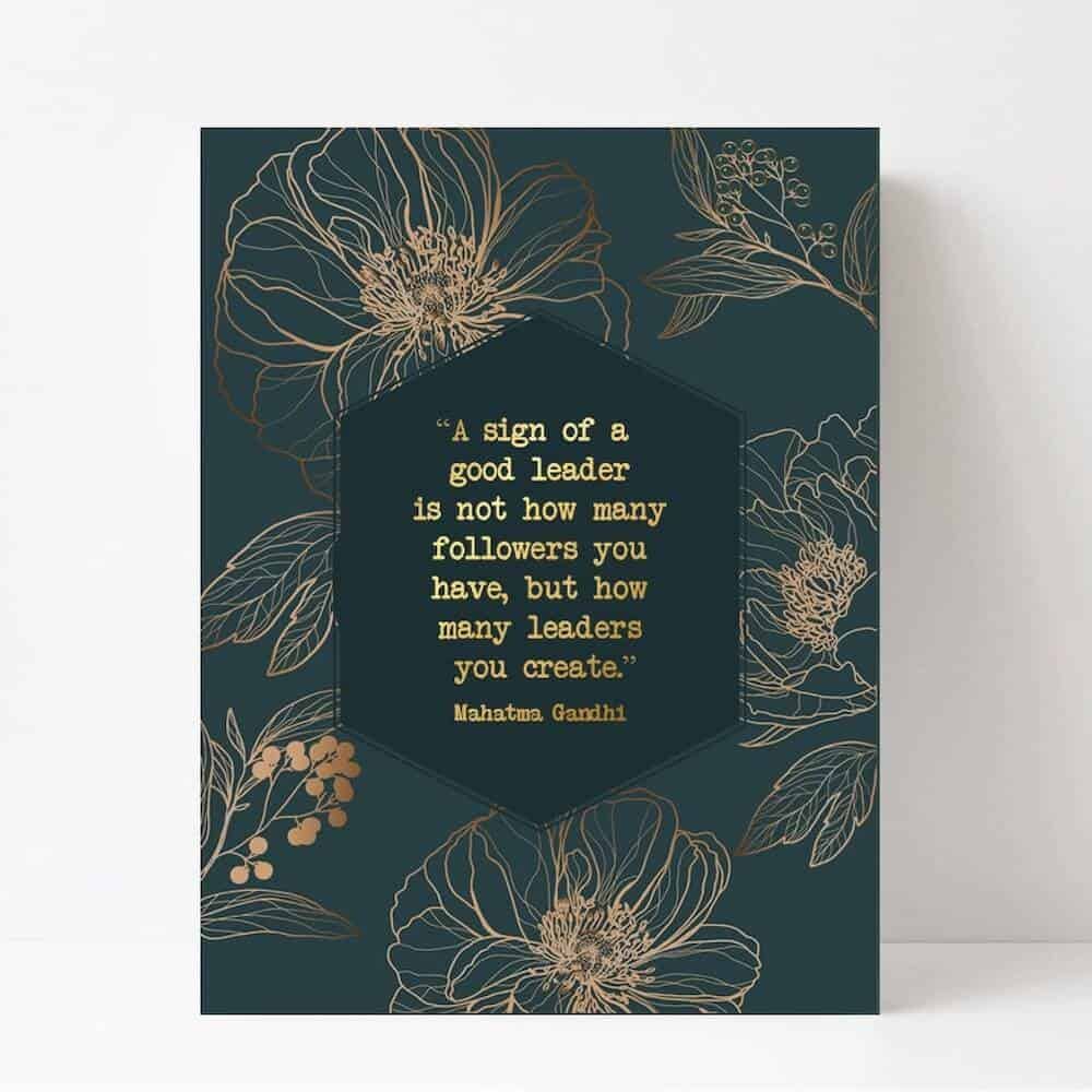 a metallic print with the quote about female leadership